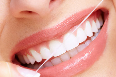 Girl doing dental flossing